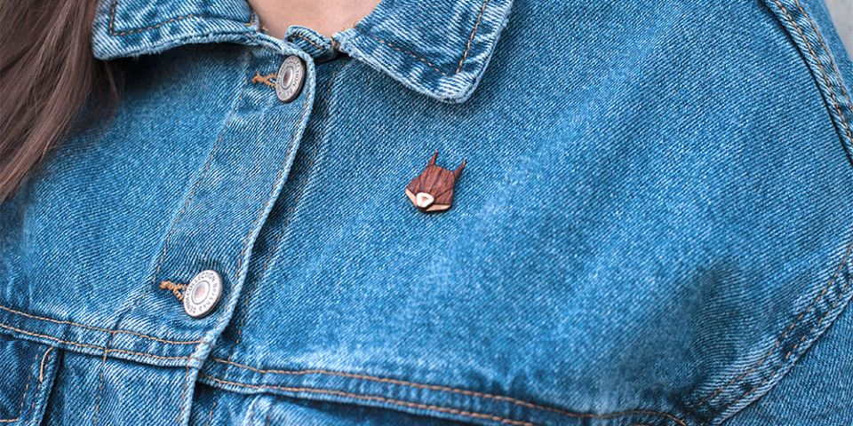 A woman in jeans jacket with the wooden brooch Squirrel Brooch